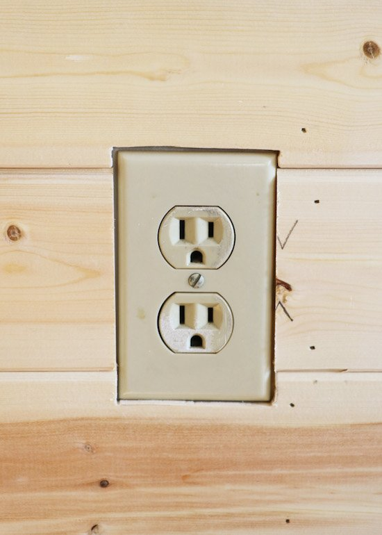 Cutting outlet in shiplap wall