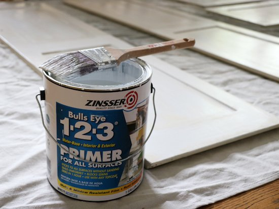 Adding primer to cabinets